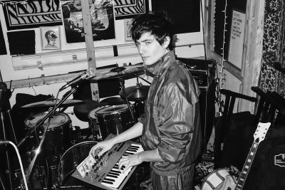 Spencer Draeger of Dräger playing a synthesizer in the studio
