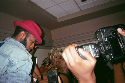 Party goers taking pictures of Megan Thee Stallion