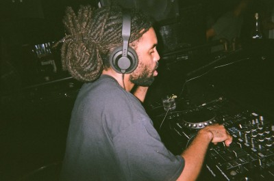 A DJ mixing at the turntables